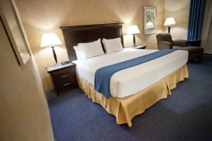 A bed or beds in a room at Holiday Inn Express Grover Beach-Pismo Beach Area