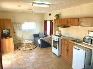 A kitchen or kitchenette at Cute Private Studio Flat with AIRCON!