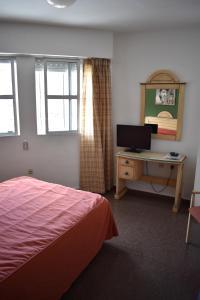 Cama o camas de una habitación en Hotel Los Bartolos
