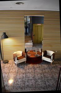 Zona de estar de Hotel Los Bartolos