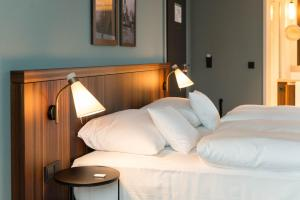 A bed or beds in a room at The Liberty
