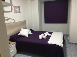 A bed or beds in a room at Albahicín