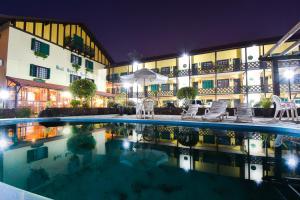 The swimming pool at or near Sul Serra Hotel