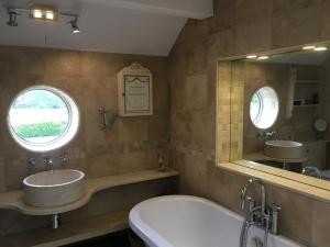 A bathroom at Garden Cottage