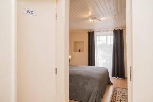 Cama o camas de una habitación en Lisbon Belém Guesthouse