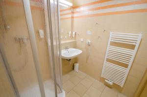 Ванная комната в JUFA Hotel Leibnitz