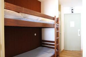 A bunk bed or bunk beds in a room at Lac Blanc