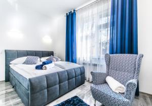 Łóżko lub łóżka w pokoju w obiekcie City Lights Bosacka