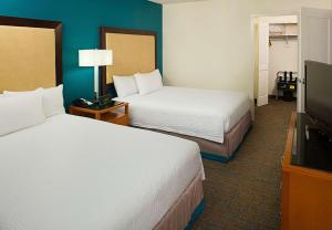 A bed or beds in a room at Residence Inn by Marriott Washington - DC/Foggy Bottom