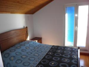 A bed or beds in a room at Casa de São José