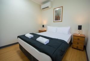 A bed or beds in a room at Hidden Valley Holiday Park Darwin