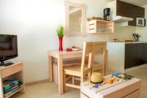 A kitchen or kitchenette at Résidence Goélia Les Jardins de l'Oyat