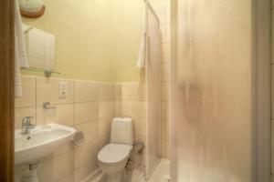 Ванная комната в Mini Hotel City On Nevsky