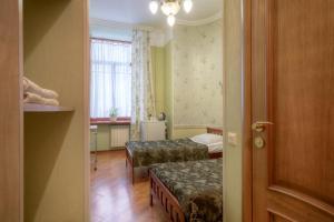 Кровать или кровати в номере Mini Hotel City On Nevsky