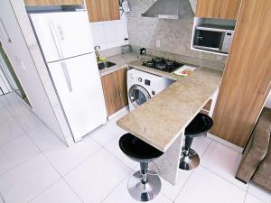 A kitchen or kitchenette at RSH Flats Princesa