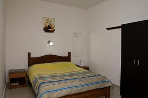 A bed or beds in a room at Hotel Villa Real de Cucuta