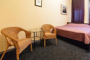 Кровать или кровати в номере Simple Komnaty na Nekrasova