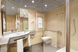 Ein Badezimmer in der Unterkunft Swiss-Belhotel du Parc Baden
