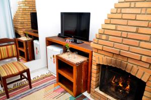 A television and/or entertainment centre at Hotel Bertell