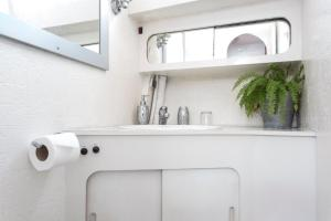 A kitchen or kitchenette at Riverscapes Classic French Motor Yacht