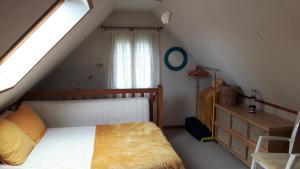 Een bed of bedden in een kamer bij Le Mouton Blanc