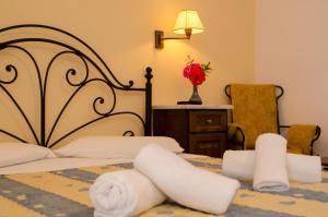 Кровать или кровати в номере Lakki Village