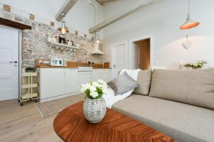 A kitchen or kitchenette at Apartments Santa Lucia Exclusive