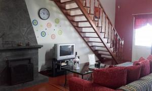 A television and/or entertainment center at Country House in Azores - S. Miguel
