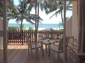 A balcony or terrace at Yula Beach