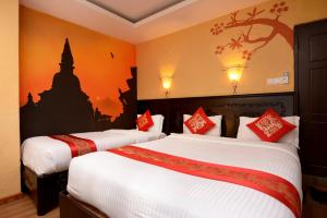 A bed or beds in a room at Kasthamandap Boutique Hotel