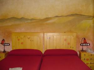 Cama o camas de una habitación en Casa Rural las Médicas