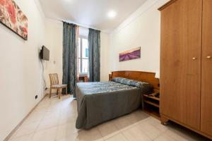A bed or beds in a room at Hotel Domus Praetoria