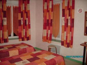 Un ou plusieurs lits dans un hébergement de l'établissement Terroir et Tradition A La Ducasse