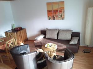 Ein Sitzbereich in der Unterkunft Abelia Gästehäuser