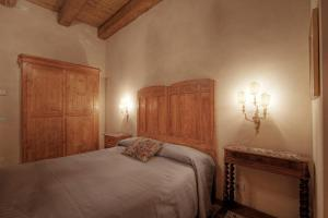 A bed or beds in a room at La Fornasaccia