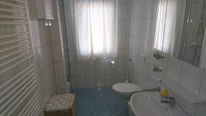 Een badkamer bij Pension Bergblick