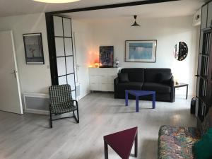 A seating area at Appartement Residence Le Fairway