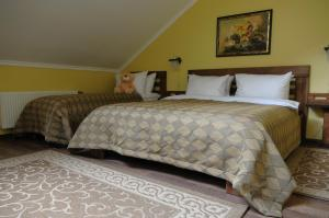 Кровать или кровати в номере MelRose Hotel