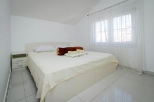 A bed or beds in a room at Panorama lux apartment