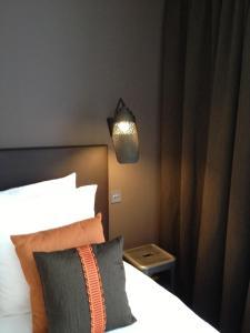 A bed or beds in a room at La Maison de Léa