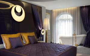 A bed or beds in a room at Sura Design Hotel & Suites