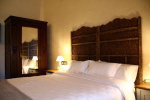 Cama o camas de una habitación en La Casona de Torió
