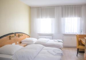 Una cama o camas en una habitación de Pension Tokus