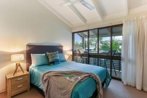 A bed or beds in a room at Kananda Beach House