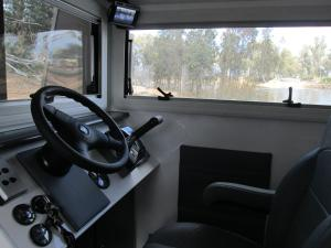 A kitchen or kitchenette at Moama on Murray Houseboats