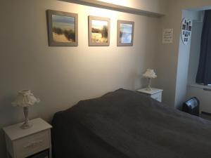 Un ou plusieurs lits dans un hébergement de l'établissement Apartment Havenzicht