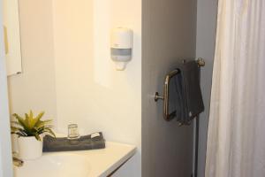 Ванная комната в Hotell Angöringen