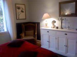 Un ou plusieurs lits dans un hébergement de l'établissement La corniche