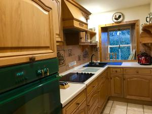 A kitchen or kitchenette at Errichel House and Cottages