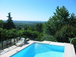 A view of the pool at La Villa du Rhône or nearby